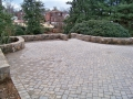 paver parking court with fieldstone walls