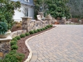 paver driveway with cobble edging and fieldstone walls and columnsns