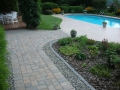 paver path edged with cobbles and chalet