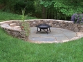 fieldstone seat wall with stone slab steps and bluestone patio