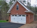 brick garage with carriage doors