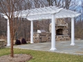 cedar pergola painted white with fiberglass columns