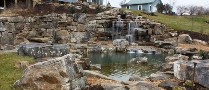 natural swim pond with 8' water falls