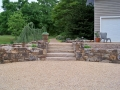 fieldstone retaining wall with stone slab stairs