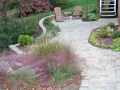 paver walkway and patio retained by a segmental wall